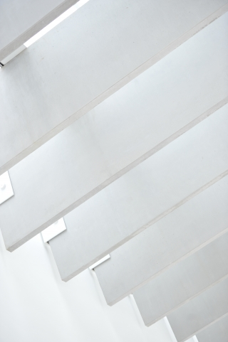 A close up of white boards across a white wall and ceiling